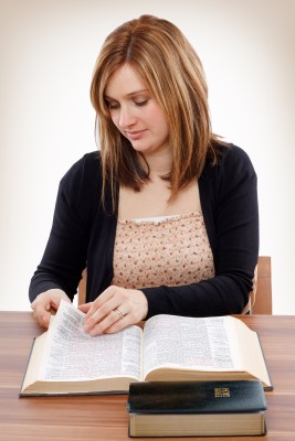 Young Christian Woman Studying the Bible